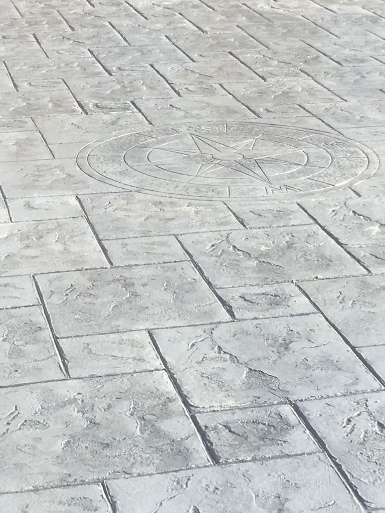 Pattern imprinted concrete driveway- with compass imprint,