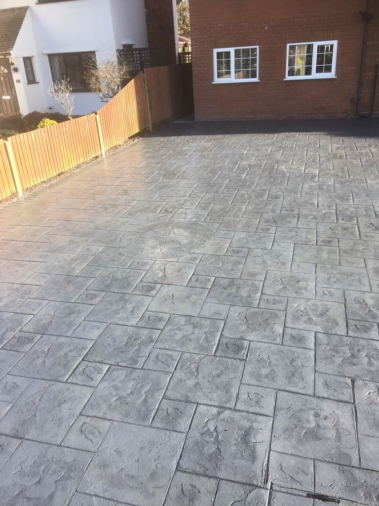 Pattern imprinted concrete driveway- with compass imprint..