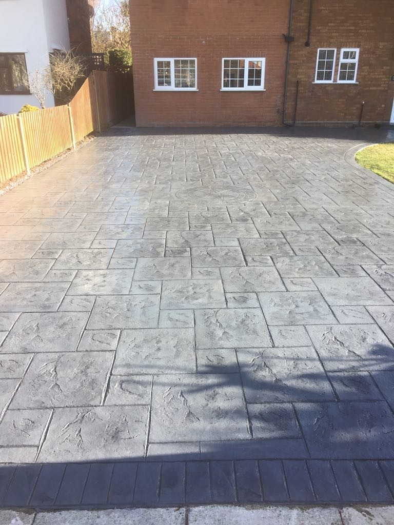 pattern imprinted concrete driveway with compass imprint pattern
