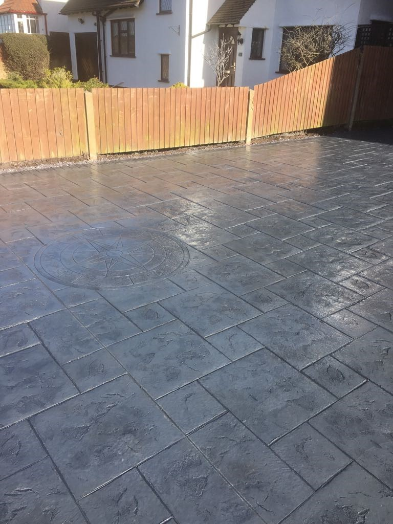 Pattern imprinted concrete driveway- with compass imprint